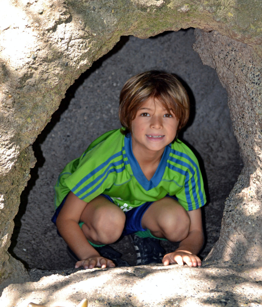 Theo in a cave at the zoo